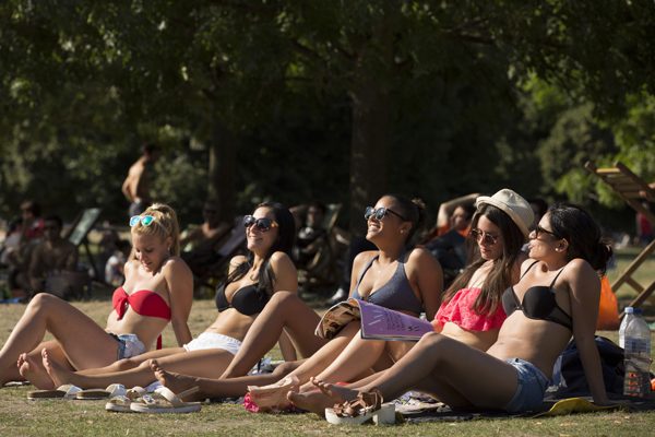 LONDON, ENGLAND - AUGUST 22:  A group of spanish woman relax in the sunshine in Hyde Park on August 22, 2015 in London, England. Weather in the capital is expected to reach 30 degrees today, with heavy rain moving in towards the end of the weekend.  (Photo by Dan Kitwood/Getty Images)